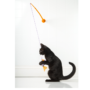 Black cat standing on its legs, playing with fish toy, Hartz SKU 3270088538