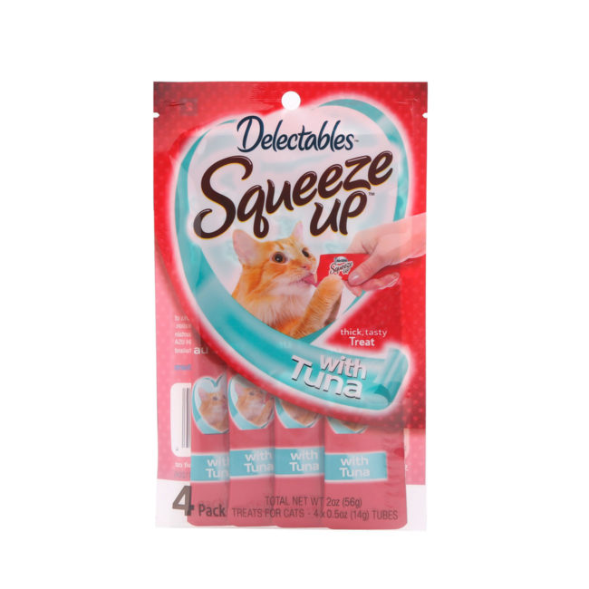 Delectables SqueezUp tuna is the first gourmet wet cat treat where feeding is interactive. Front of package picturing a cat eating from a squeezeup tube being held by a hand.