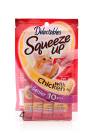 Delectables SqueezUp chicken senior cat treat is the first gourmet wet cat treat where feeding is interactive. Front of package picturing a cat eating from a squeezeup tube being held by a hand.