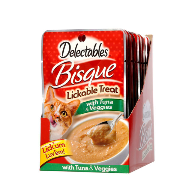 Front of angled Hartz Delectables Lickable Treat Bisque with Tuna and Veggies carton. Delectables Lickable Treat is the first lickable wet cat treat.