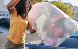 woman throwing out trash, disposing of flea and tick products
