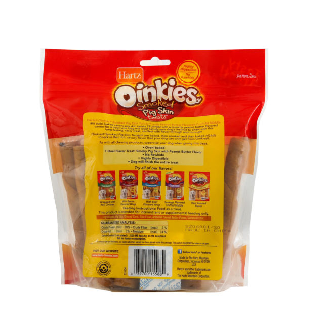Hartz oinkies smoked pig skin twist, peanut butter flavored, crunchy middle, Hartz SKU#3270015588. Back of package of crunchy dog treat..
