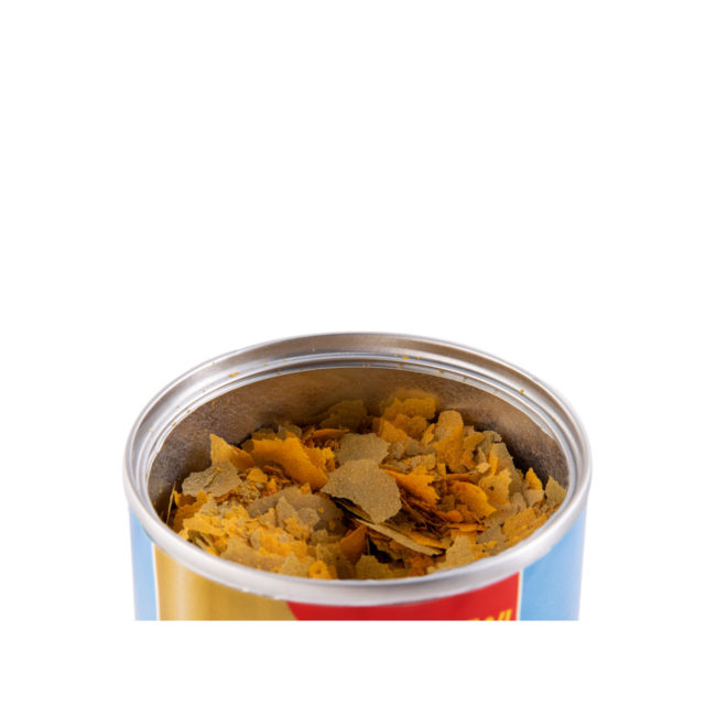 Wardley Clear Water probiotics tropical fish food. Image of an open can of fish food. Wardley SKU#4332415791