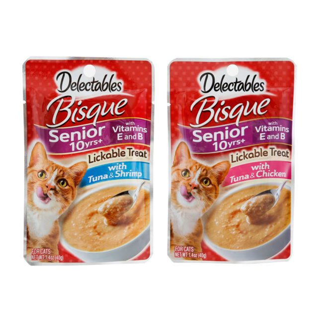 Delectables lickable treat, senior bisque variety pack. Tuna & chicken and tuna & shrimp senior cat treats. Front of pouches Hartz SKU#3270012019